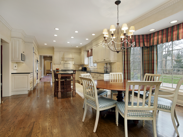 open kitchen with off white kitchen cabinets and window trim