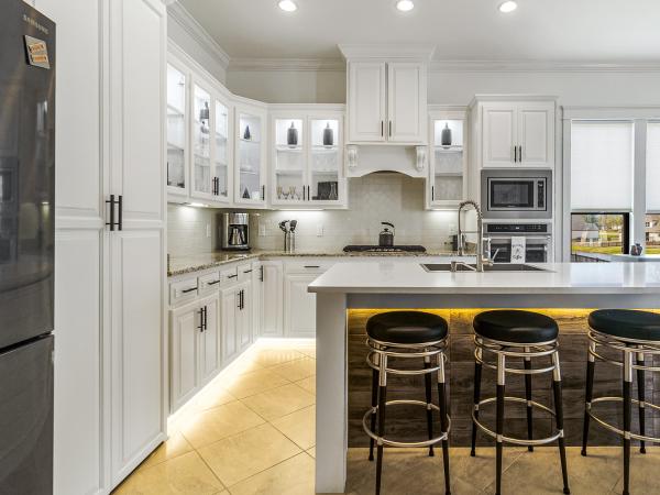 white kitchen with dark bar stools